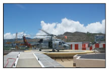 Seahawk helicopter on trauma center heliport. Extensive modifications for improved safety, designed and implemented by Raymond A. Syms & Associates