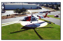 USCG helicopter lands at medical heliport in Nags Head, NC, cited and designed by Ray Syms.